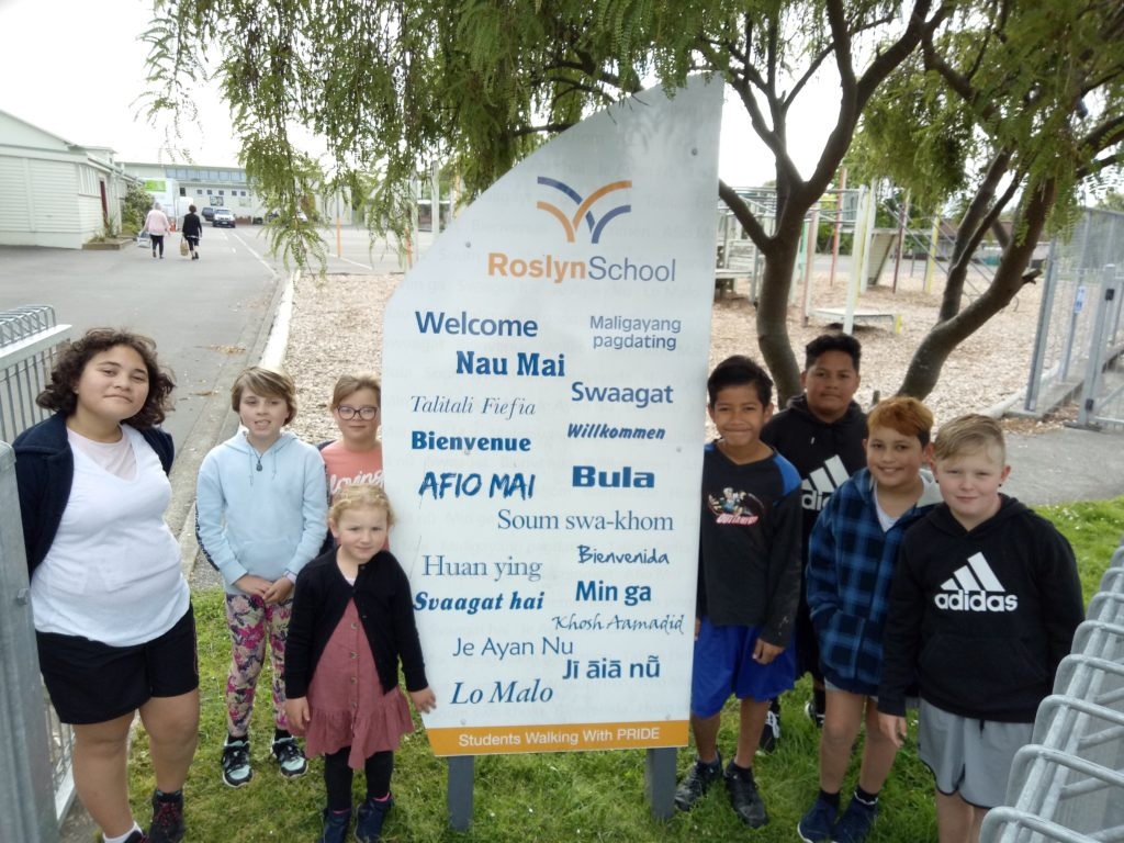 Image of school children smiling at Roslyn School in Palmerston North
